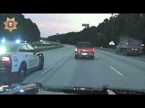 Dashcam video of a police chase shows a Forsyth County deputy's first PIT maneuver.