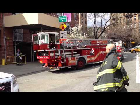 FDNY TILLER HOOK & LADDER TRUCK 5 RETURNING TO FIREHOUSE AFTER BUILDING ALARM IN LOWER MANHATTAN.