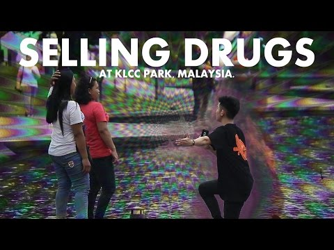SELLING DRUGS PRANK AT KLCC PARK MALAYSIA!