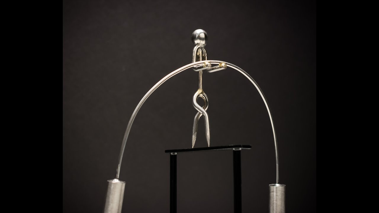 The tightrope walker kinetic balancing desk toy physics for Kinetic desk sculpture