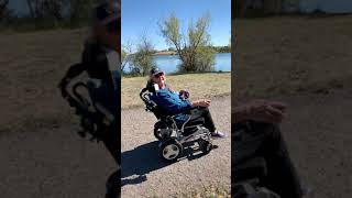 Porto Mobility Customer Enjoying Her Ranger Reclining Lightweight Foldable Electric Wheelchair