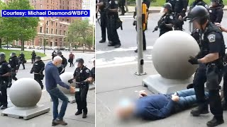 Buffalo officer shoves elderly protester in video