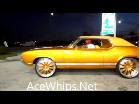 "AceWhips.NET- Gold Oldsmobile Cutlass on 24"" ASANTIS Slidin"