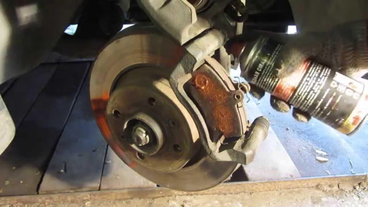 Замена передних тормозных колодок Рено Логан Renault