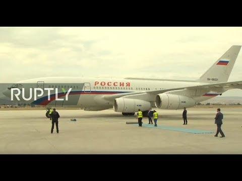 : Vladimir Putin arrives at Esenboga Airport in Ankara