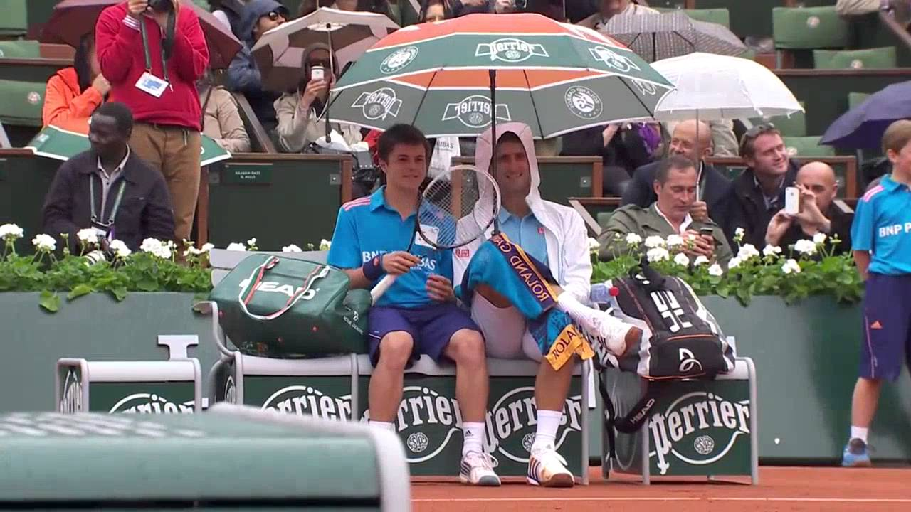Novak Djokovic Shelters Ball Boy From Rain During French Open Youtube