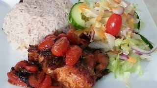 Pot Roast Chicken Served With Rice And Peas And Green Salad