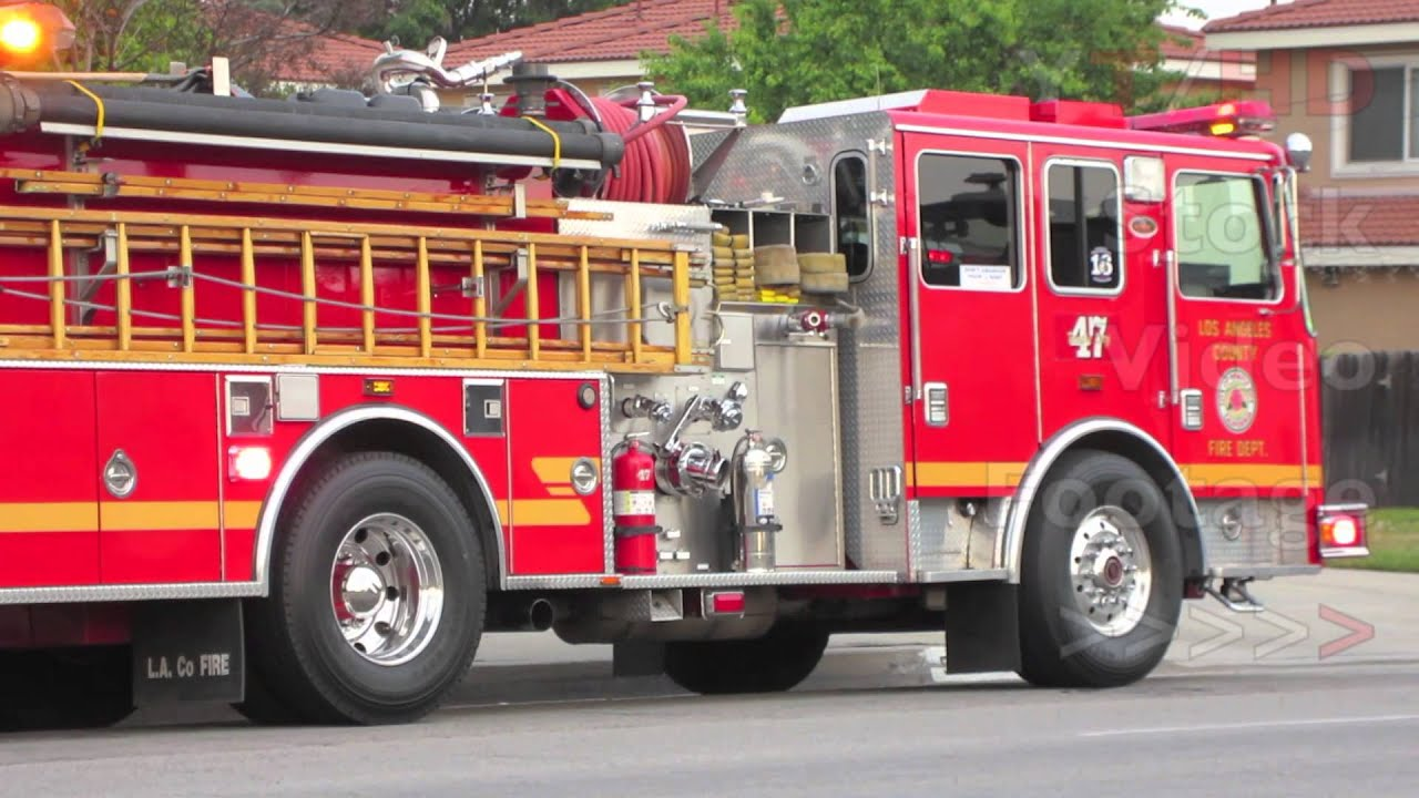 Red Fire Truck Engine Responding W Flashing Lights Parked
