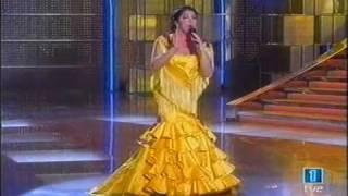 Isabel Pantoja Capote de grana y oro