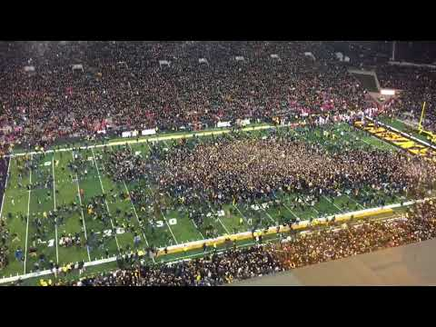 Iowa fans rush the field after beating Ohio State, 55-24