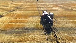 Field Drainage, Inc tiling a field near Brooks, MN.