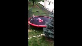 Mom jumping on trampoline can