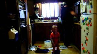 Wendy baking muffins, Mathew Potty training.