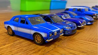 Blue Diecast Model Cars Stopped By Hand