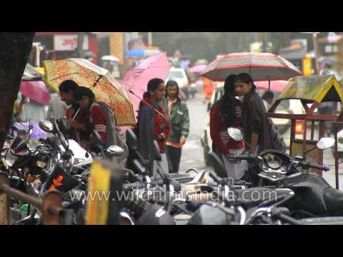 College girls enjoying rain in Panchgani
