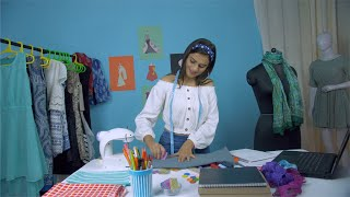 Successful young Indian fashion designer working on her office desk - dressmaker or tailor concept