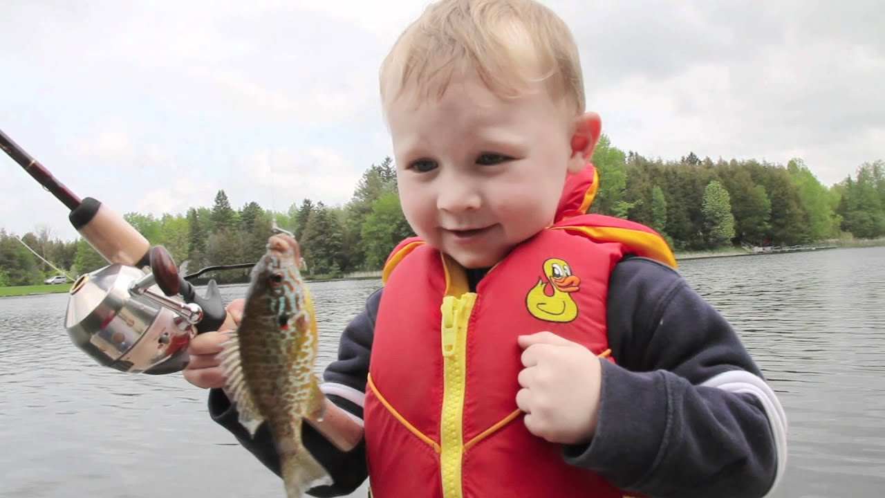 Boy 39 s awesome reaction to catching his first fish youtube for Little boy fishing
