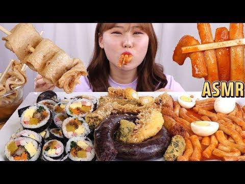 eating-assorted-korean-snacks.-spicy-rice-cake,-blood-sausage,-fried-foods,-fish-cake,-kimbap