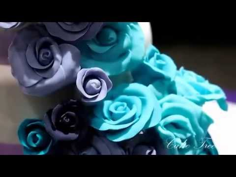 Wedding Cake - Cascading Roses in Shades of Purple and Aqua Blue.