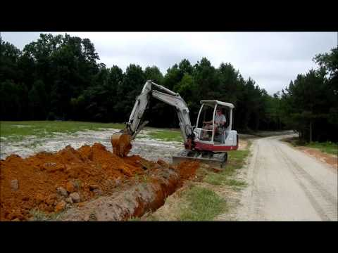Trenching with the Mini Excavator - YouTube