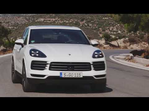 Porsche Cayenne in White Driving on the road