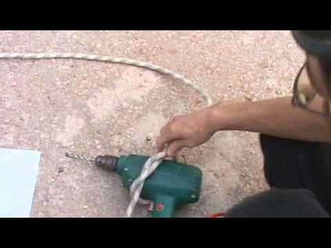 Tall Building Repairs: Fastening Tools to Rope