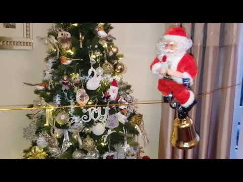 Unicycle santa. Musical, Singing, dancing, santa toy on tightrope