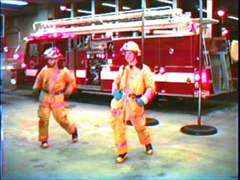 Firefighters Line Dance to Dumas Walker