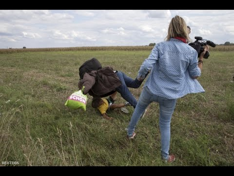 Hungarian journalist kicking migrants on Camera