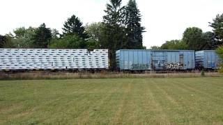 A mix of roadnames and freight car types. Grand Trunk Western