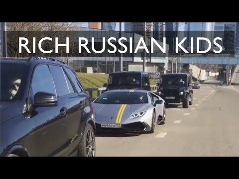 Millionaire rich kids luxury lifestyle. Drifting super cars in Moscow streets. Cars doing donuts