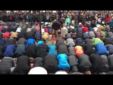 Muslims praying together during immigration rally at Copley Square, Boston