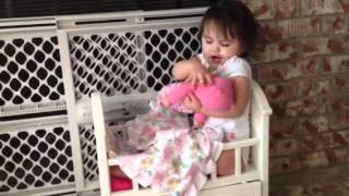 Playing In Her Baby Doll Crib