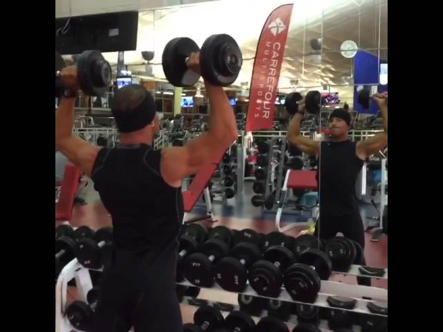 Standing shoulder dumbbell press.