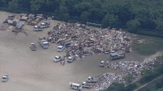 Death toll from Japan floods rise, dozens still missing
