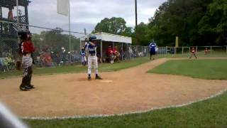 Jacob Kennedy lets go of bat