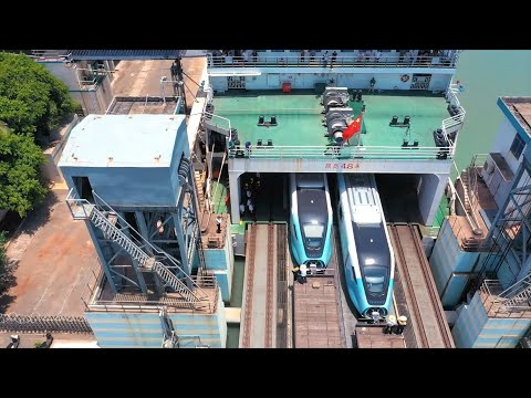 How train takes ferry to cross strait in south China?