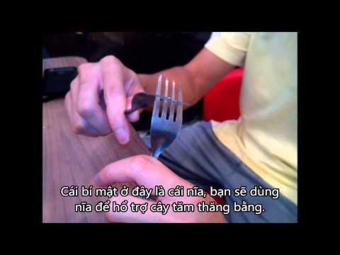 Hướng dẫn giữ thăng bằng cây tăm trên vành miệng lon nước - PNhan.Com