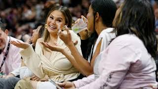 DWYANE WADE:  Hilariously Falls on Chrissy Teigen and John Legend During Final Miami Game [PICS]