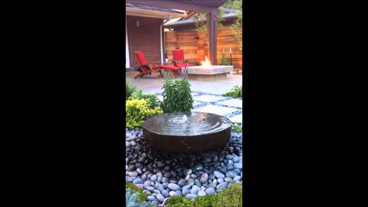 modern backyard stone water feature and concrete fire pit youtube. Black Bedroom Furniture Sets. Home Design Ideas