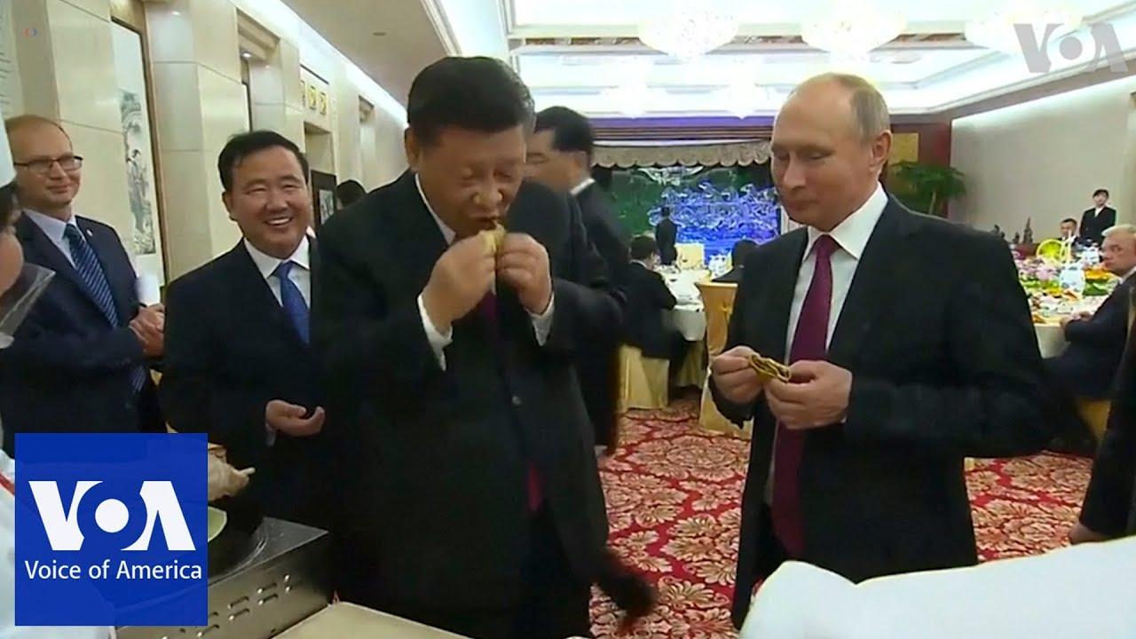 Russia's Putin and China's Xi Jinping learn to make Chinese dumplings