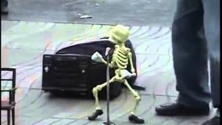 Skeleton puppet dances the twist