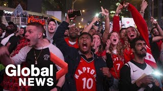 Toronto Raptors fans celebrate in streets after defeating Milwaukee Bucks in 6 games