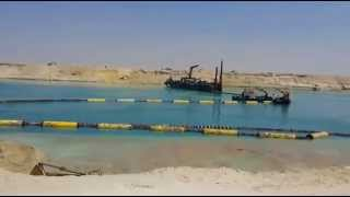 In a scene of drilling and dredging the new Suez Canal March 25, 2015