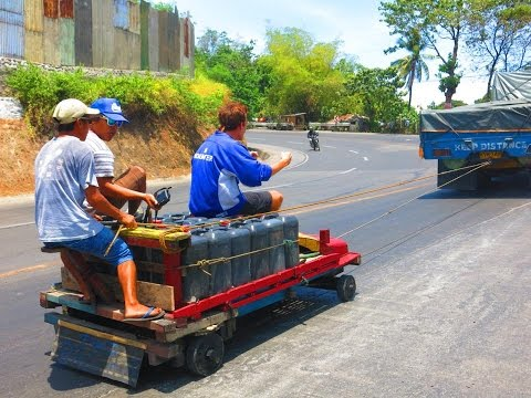 Filipino Giant Wooden Go Karts Behind Cars - Transporting Water With Kariton