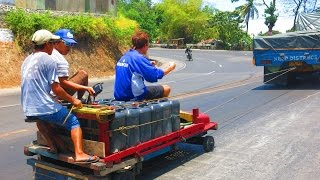 Filipino Giant Wooden Go Karts Behind Cars - Transporting Water With Kariton