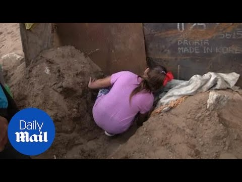 Mother and daughter crawl under the border wall - get detained