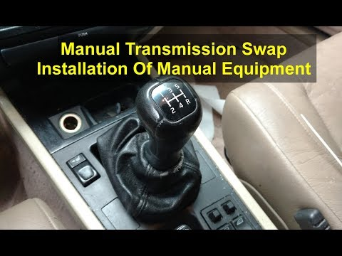 Installing the manual transmission and associated items. - Manual Conversion