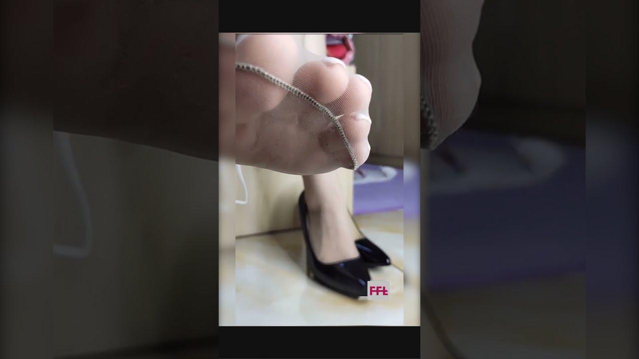 focus on white toe nails feet in ultra thin nylon stockings