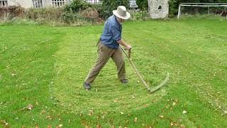 Autumn mowing lawns and meadows with a scythe thumbnail